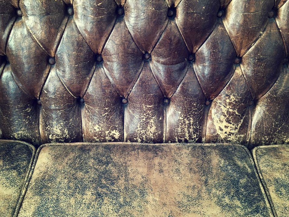 if this sofa could tell... Brown Close-up Cozy Favorite Places Full Frame Furniture Have A Seat Interior Leather Old-fashioned Pattern, Texture, Shape And Form Patterns Sofa Storytelling Structure Vintage