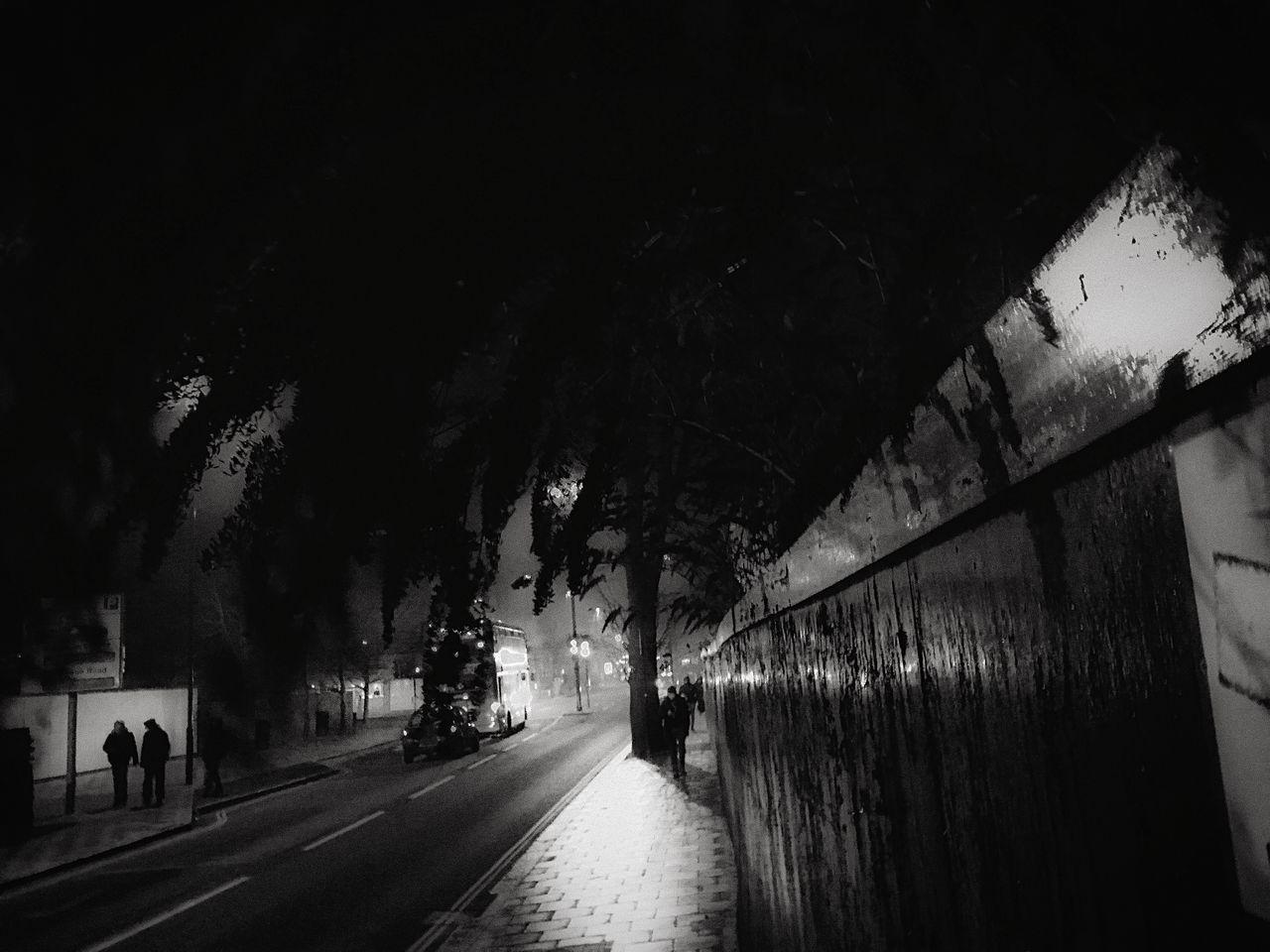 Tree Outdoors Real People Night Atmosphere London Lifestyle EyeEm Bnw EyeEm Best Shots - The Streets Street Light Street City EyeEm Best Shots - Black + White The Week Of Eyeem Black And White EyeEm Best Shots Fresh On Eyeem  Street Photography Reflections Silhouette Sidewalk Creative Photography Saturday Night
