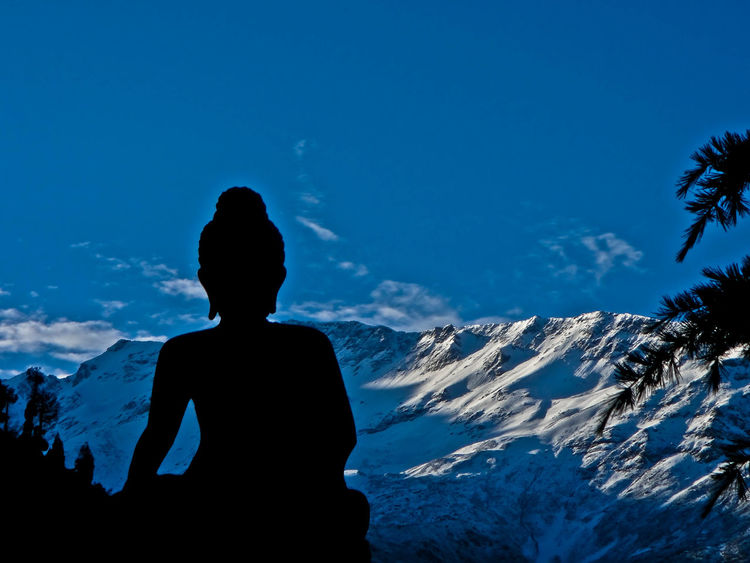 The Solitary Buddha Mountain Snow Winter Mountain Range Sky Landscape Cold Temperature Scenics Nature Outdoors Day