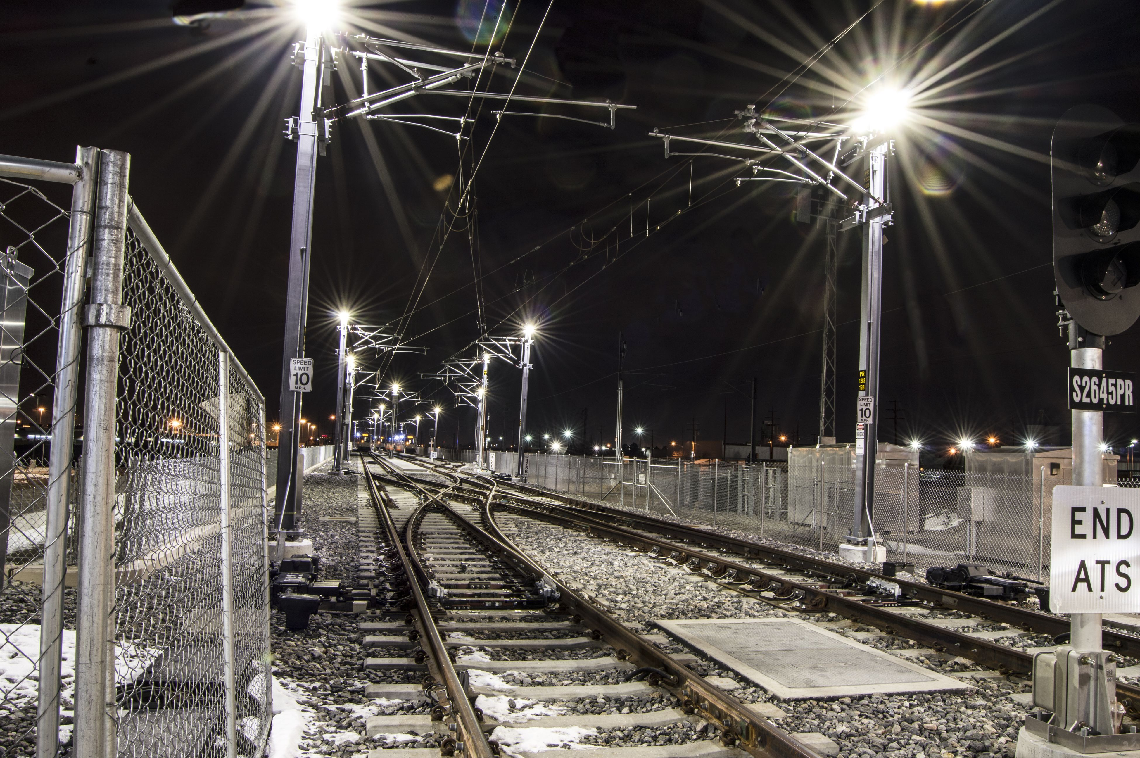 night, illuminated, railroad track, transportation, architecture, outdoors, built structure, sky, no people