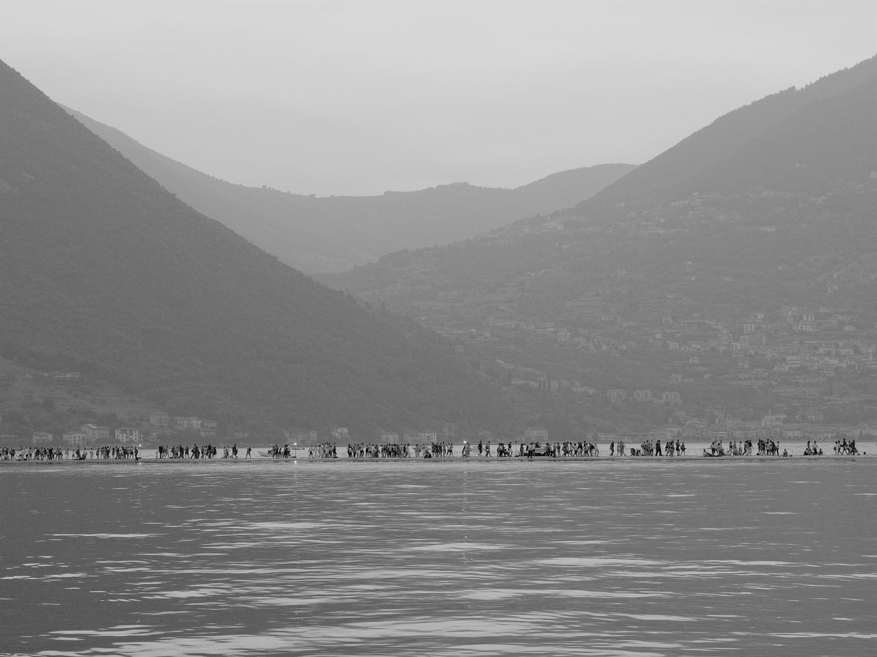 Art Beauty In Nature Christo Day Floating Piers Hill Idyllic Iseo Lake Italy Lake Landscape Mountain Mountain Range Nature No People Non Urban Scene Non-urban Scene Outdoors Remote Scenics Sky Tranquil Scene Tranquility Walking On Water Water