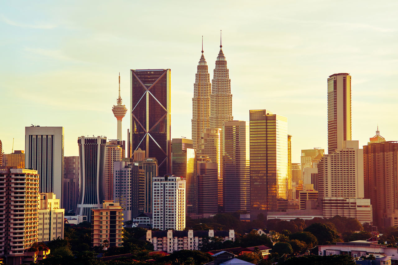 Dramatic scenery of the Kuala Lumpur city at sunset Aerial View Architecture Building Exterior Business City City Life Cityscape Corporate Business Day Downtown District Growth High Angle View Modern No People Outdoors Scenics Sky Skyscraper Sunset Tower Travel Travel Destinations Urban Skyline