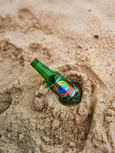 Hairoun Beer in the sand of Palm Island. St Vincent's best export. Bottle Beer Bottle Beach Sand No People Outdoors Palm Island Vacation Tropical Paradise Best Beer Beer Best  Hairoun St Vincent & The Grenadines St Vincent Man Cave No Filter Ifttt First Eyeem Photo