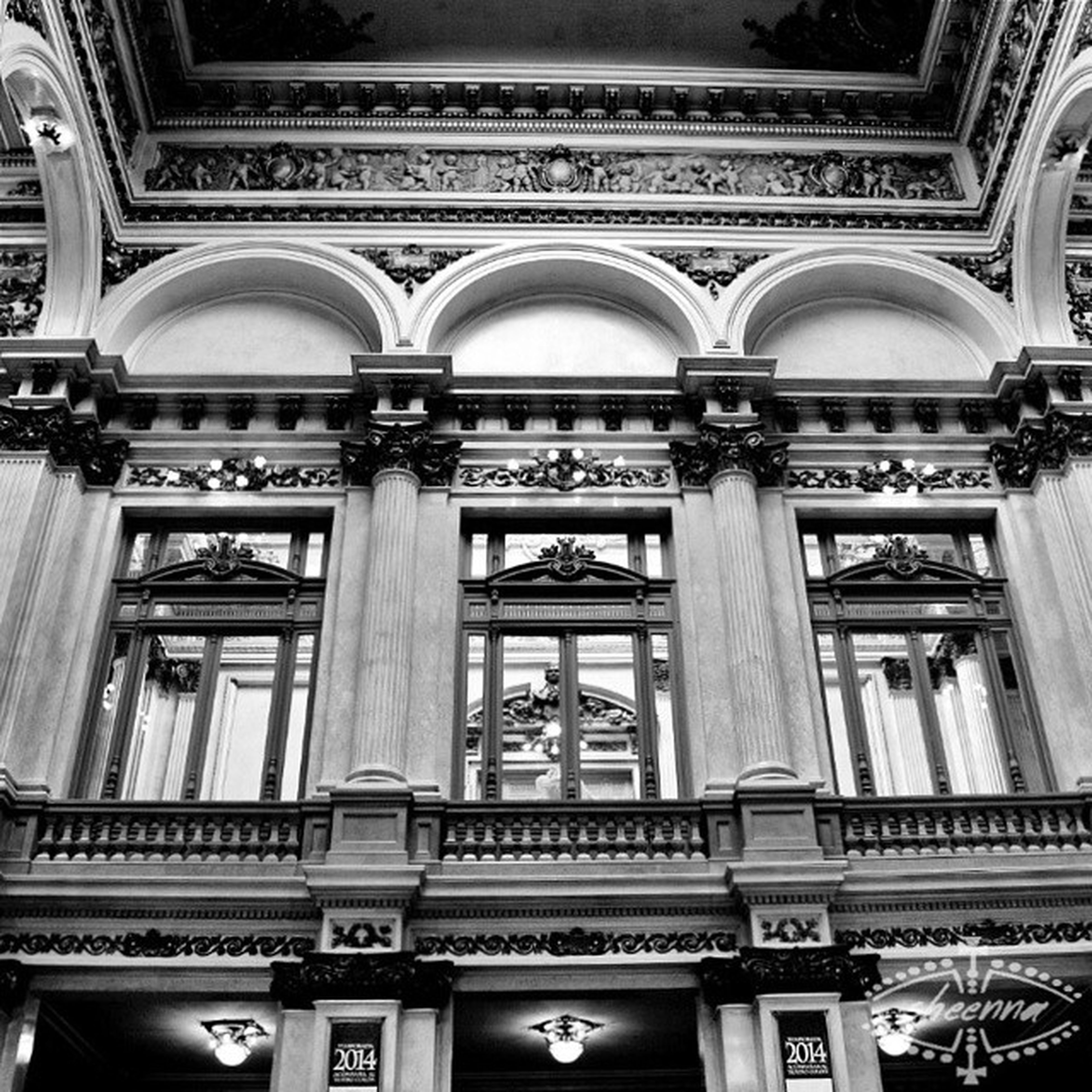 architecture, built structure, low angle view, window, building exterior, arch, ornate, indoors, building, ceiling, architectural feature, design, architectural column, history, no people, balcony, pattern, day, in a row, facade