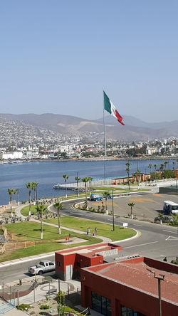 Mexico Ensenada Flag Patriotism Sea Beach Water Day Outdoors Sky Travel Destinations Politics And Government Harbor Horizon Over Water