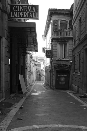 Glimpse street of the city earthquake of L'Aquila Abruzzo L'Aquila Architecture Black And White Blackandwhite Building Exterior Built Structure City Communication Day Earthquake Earthquake In Italy Earthquake L'aquila Italy No People Outdoors Reastaurant Road Road Sign Street Text The Way Forward
