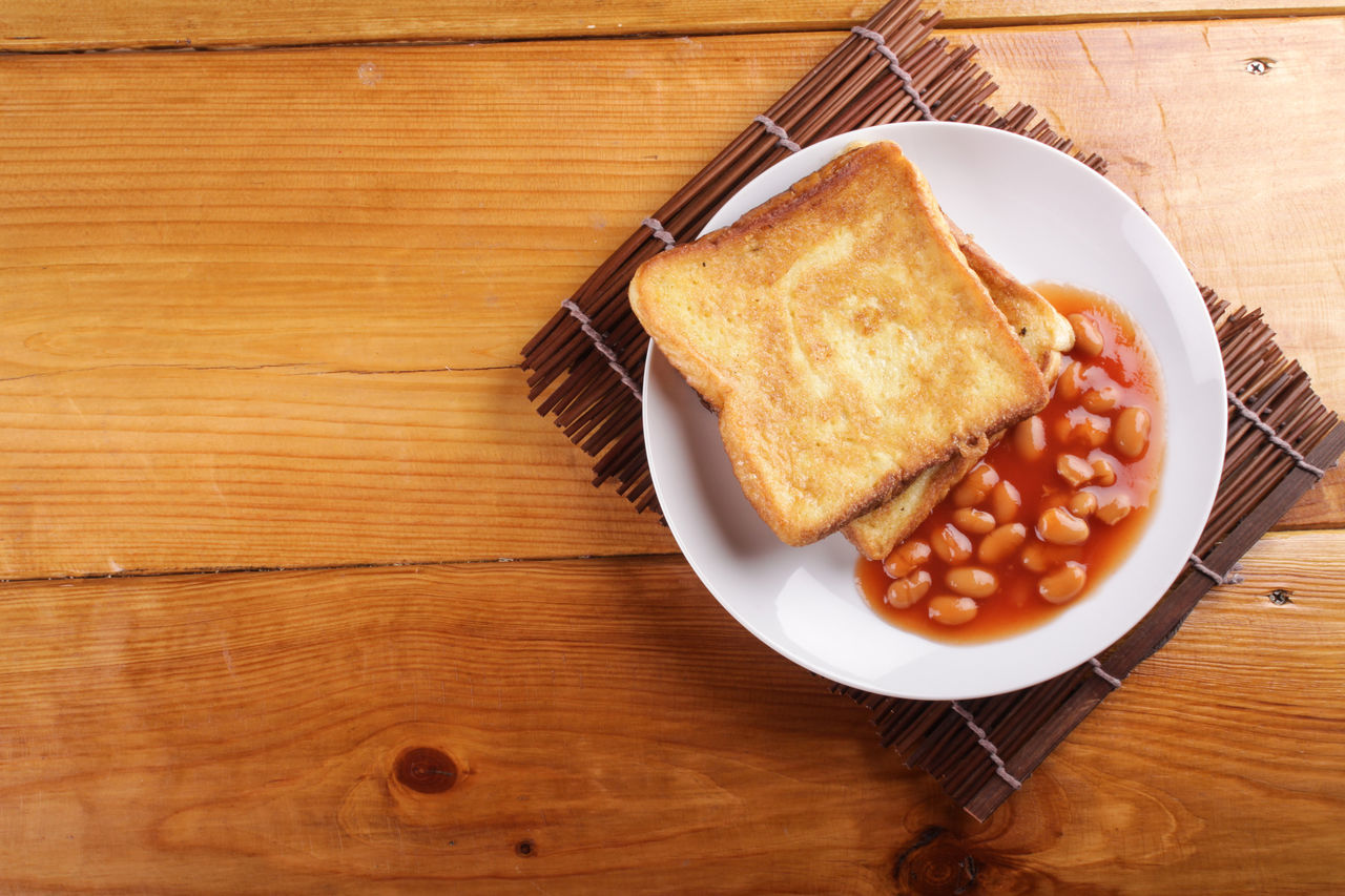 Baked Beans With Toasted Bread On Plate