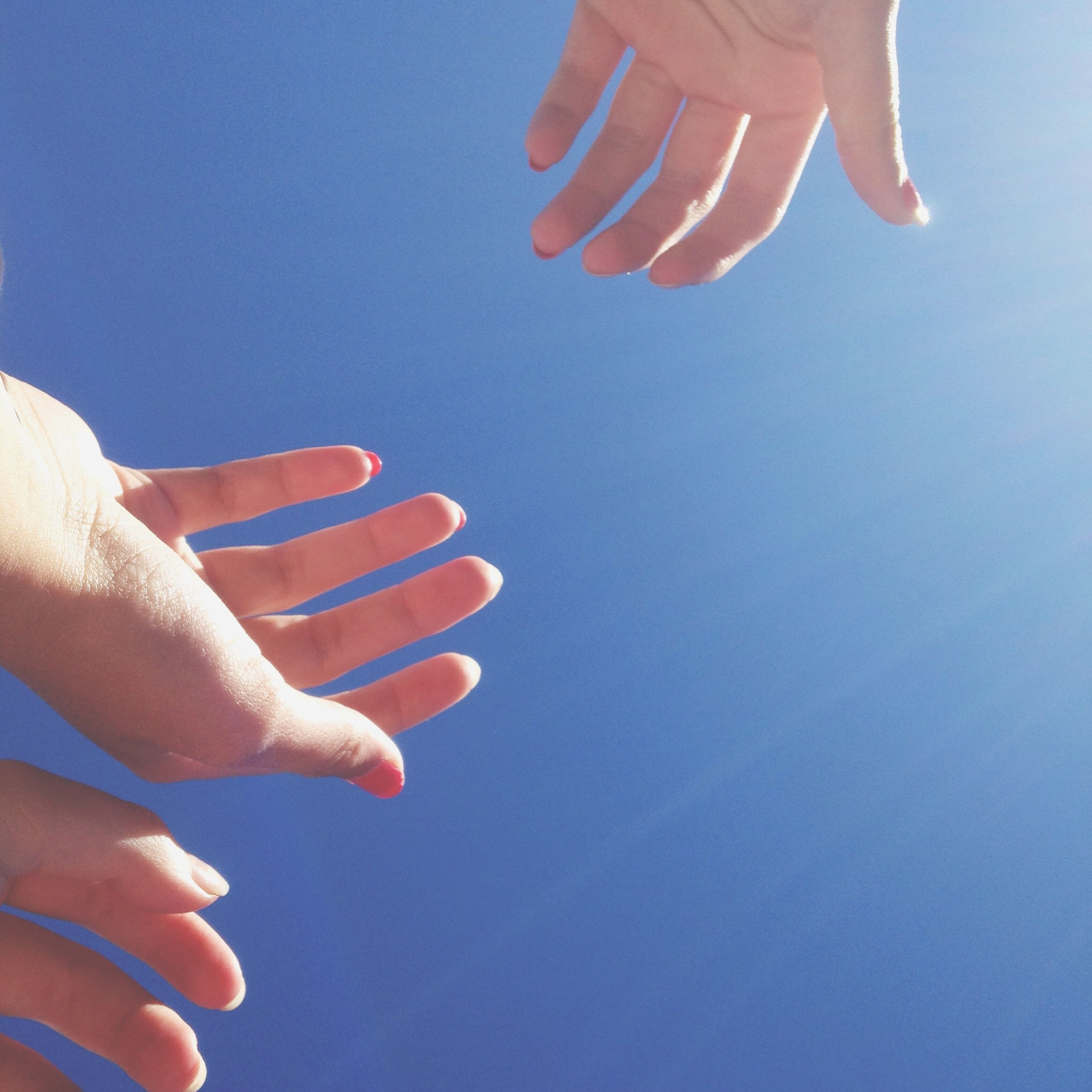 person, part of, cropped, holding, human finger, unrecognizable person, personal perspective, lifestyles, leisure activity, clear sky, blue, copy space, showing, close-up, men