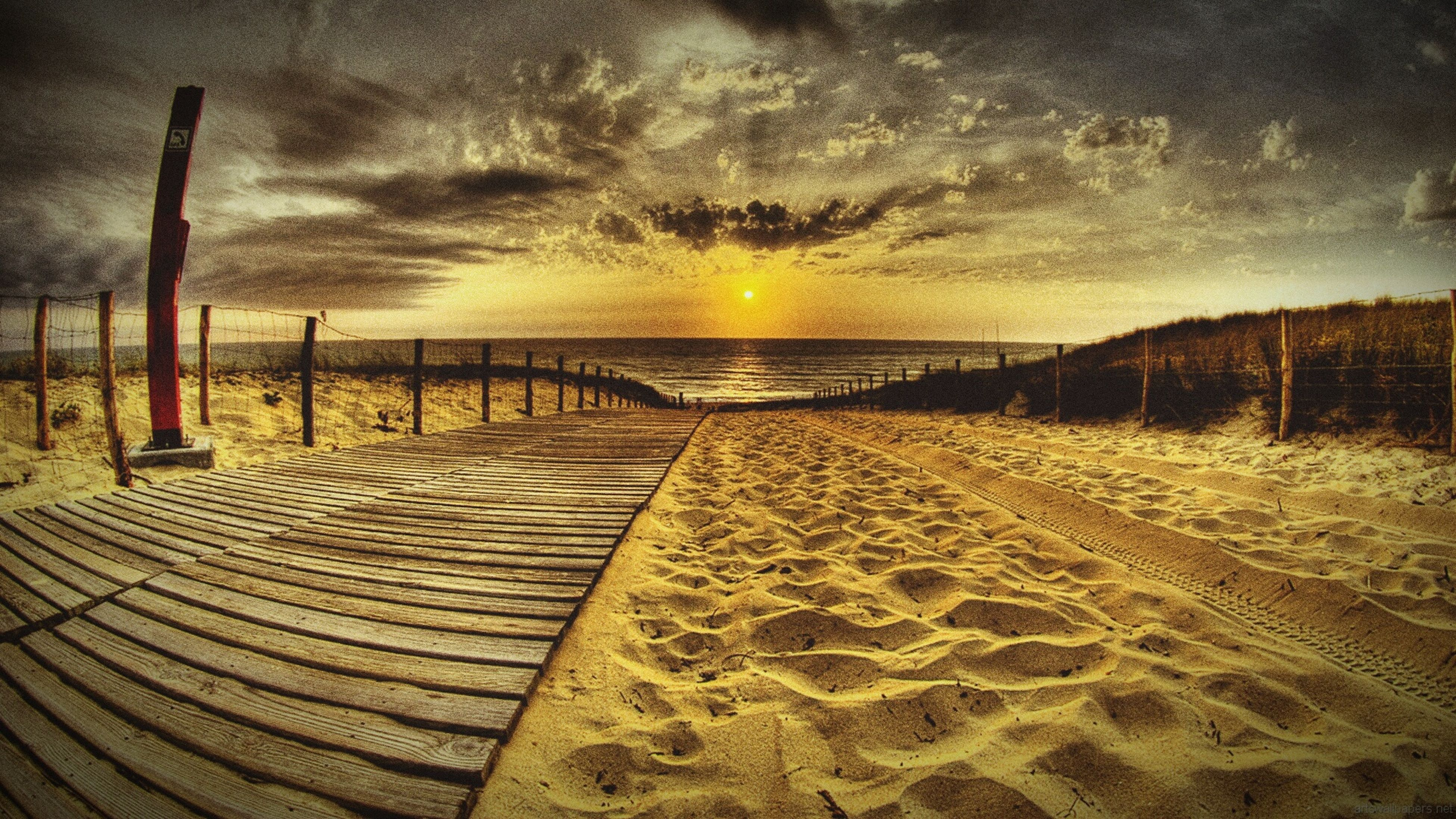 tranquility, sea, sky, tranquil scene, horizon over water, beach, sunset, scenics, the way forward, beauty in nature, water, nature, cloud - sky, sand, shore, diminishing perspective, idyllic, empty, railing, cloudy
