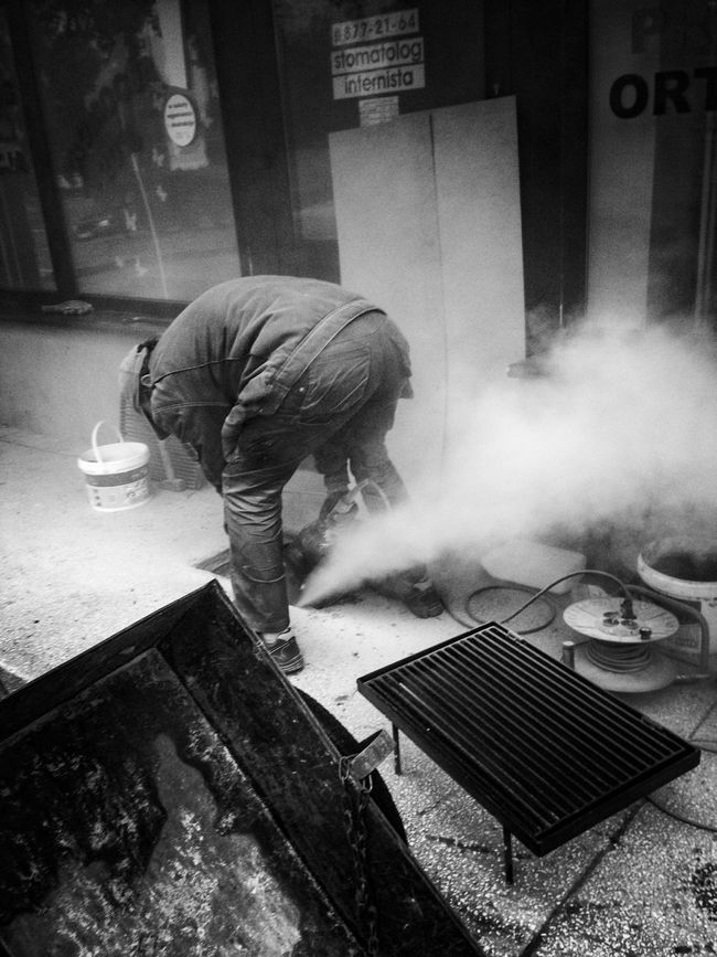 Worker Men Working My Photography Eyemstreetphoto Street Streetphotography Blackandwhite EyeEm Best Shots Streetphoto_bw Eyem Best Shots - Black + White Outdoors Warsaw Poland My Point Of View Eyem Gallery Eye4photography  Black And White Portrait Light And Shadow Smoke - Physical Structure Eyemphotography