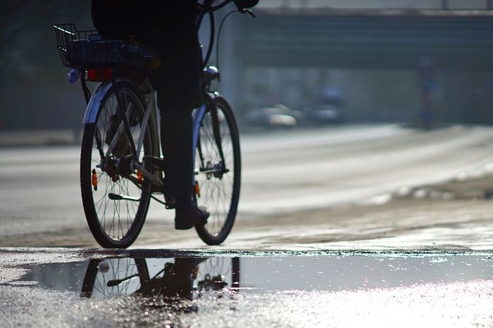 Bicycle in a Puddle Wet Street Sunny Day Puddle Reflections Bicycle Rack EyeEm Selects Bicycle Transportation Land Vehicle Mode Of Transport Stationary Street Outdoors Road No People Day