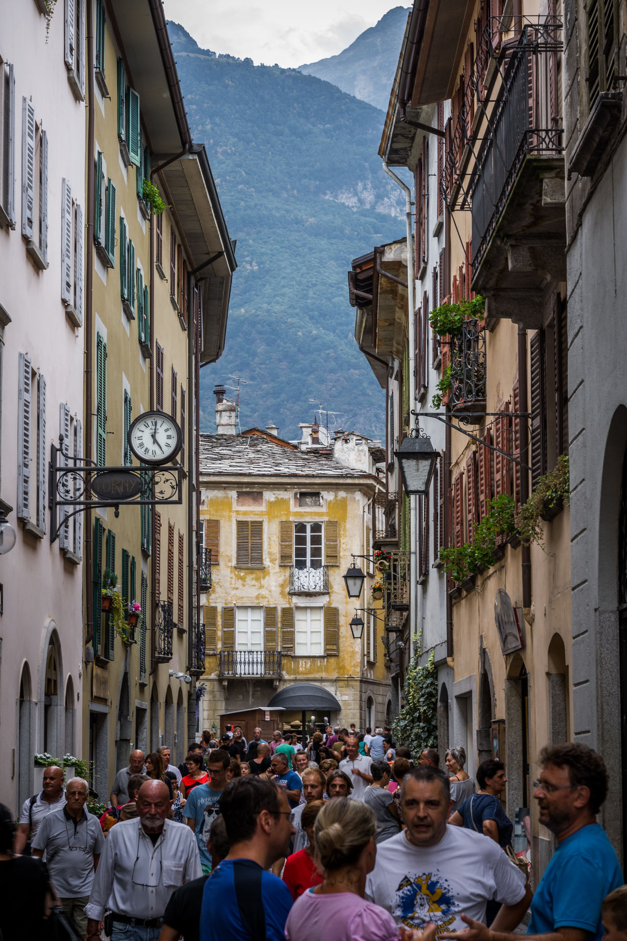 Adult Adults Only Architecture Building Exterior Built Structure Chiavenna City Cloud - Sky Crowd Day Group Of People Human Body Part Italy Large Group Of People Men Outdoors People Sky Street Street Photography Streetphotography Travel Destinations Women