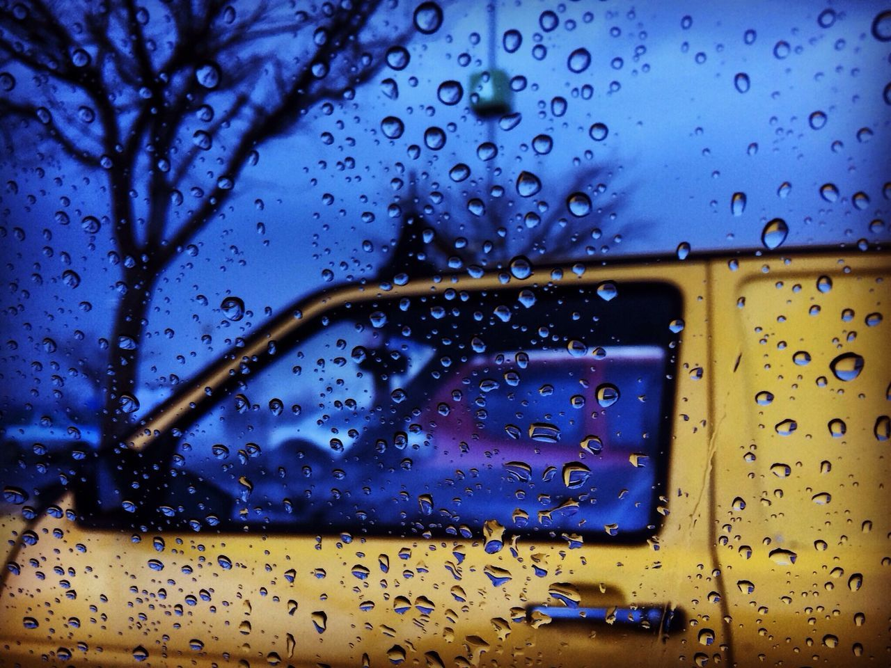 drop, rain, wet, water, raindrop, rainy season, weather, window, glass - material, droplet, water drop, no people, close-up, land vehicle, backgrounds, yellow, mode of transport, full frame, transportation, day, blue, nature, outdoors, dripping, sky, freshness