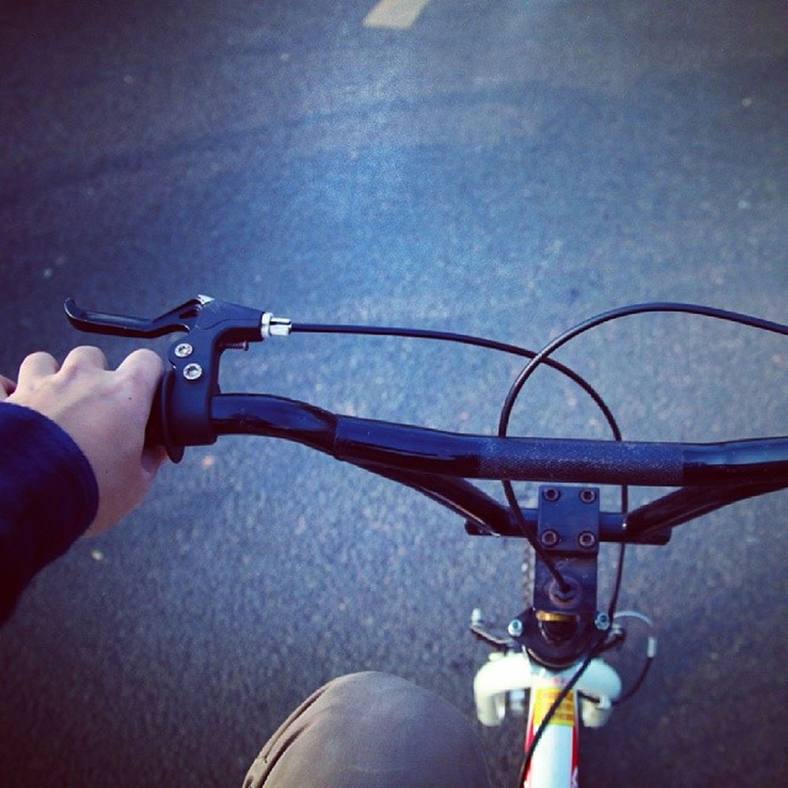 part of, person, cropped, personal perspective, holding, low section, unrecognizable person, lifestyles, men, human finger, bicycle, leisure activity, transportation, close-up, metal, high angle view