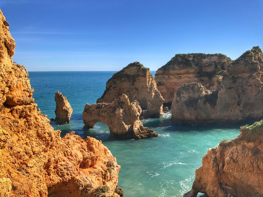Lagos Sea Rock - Object Rock Formation Scenics Water Nature Beauty In Nature Horizon Over Water Blue Tranquil Scene Clear Sky Tranquility Cliff Day No People Outdoors Beach Physical Geography Mountain Sky