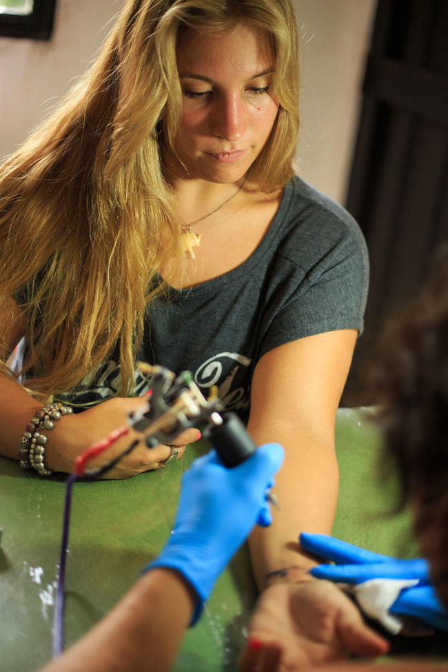 Blonde Girl getting a Tatto in her arm Beautiful Blonde Blonde Girl Casual Clothing Day Focus On Foreground Front View Getting Tattooed Happy Leisure Activity Lifestyles Long Hair Person Portrait Smiling Tattoo Tattooed Tattoos