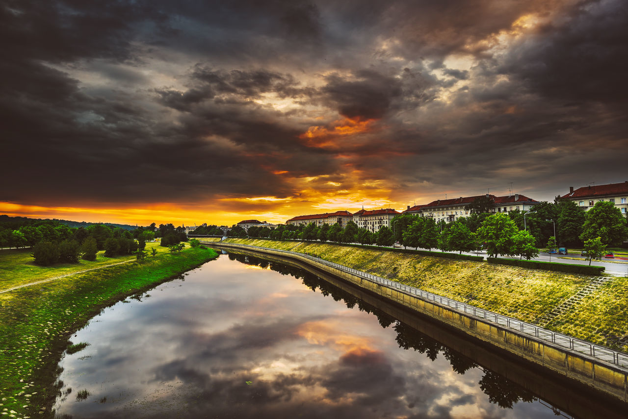Dramatic Sunset Architecture Baltic Countries Beauty In Nature Built Structure Cloud - Sky Dark Clouds Day Dramatic Sky Dramatic Sky Europe Nature No People Outdoors Reflection River Scenics Sky Sunset Tranquil Scene Tranquility Tree Water Waterfront