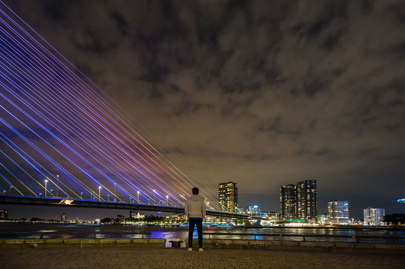 Done That. Erasmusbrug Rotterdam Architecture Built Structure City Cloud - Sky Illuminated Lifestyles Men Night One Person Outdoors Sky Travel Destinations Urban Skyline