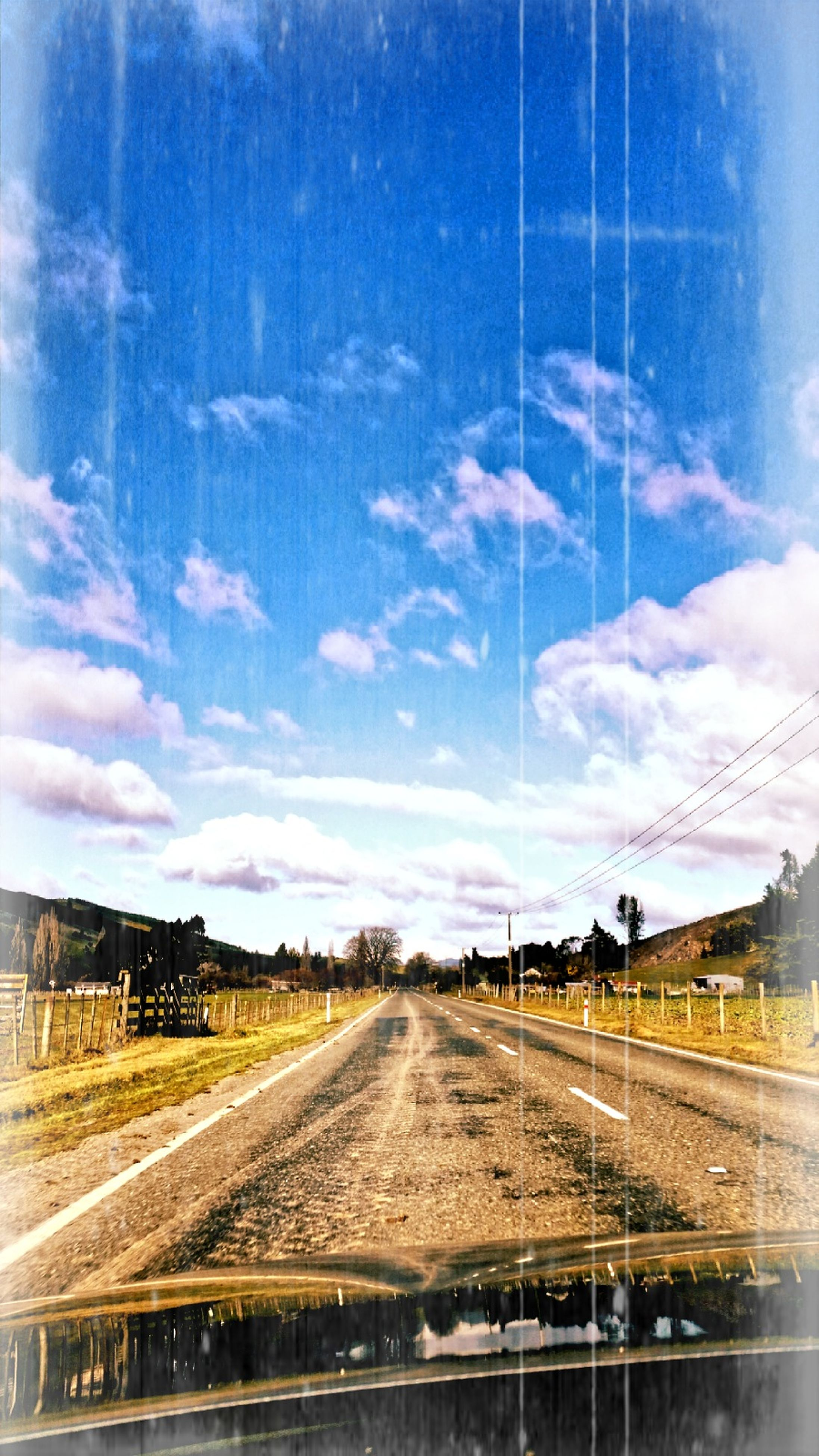 sky, railroad track, cloud - sky, the way forward, diminishing perspective, cloud, cloudy, vanishing point, no people, outdoors, nature, day, railway track, blue, weather, landscape