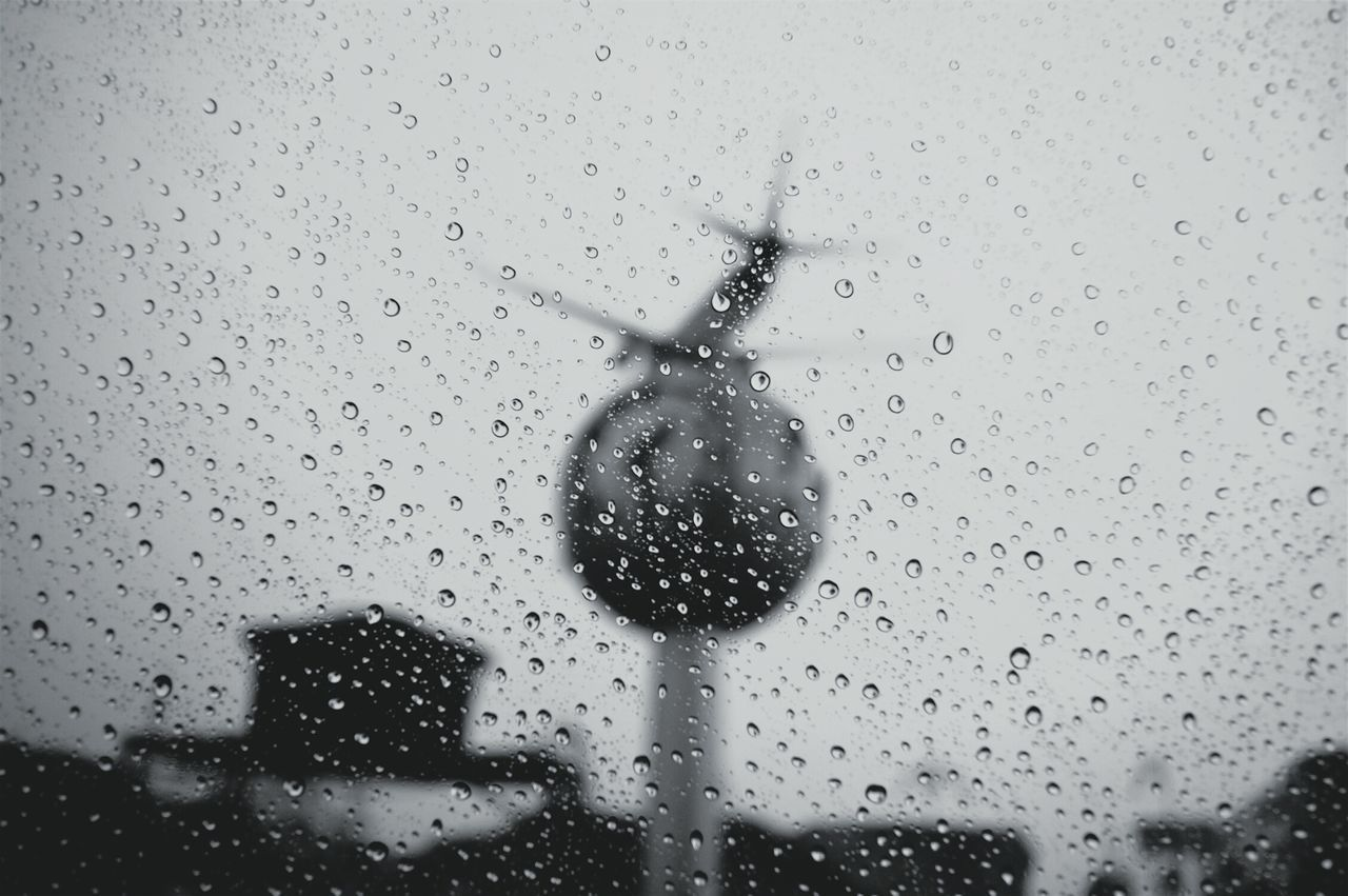 drop, transparent, glass - material, rain, water, window, wet, rainy season, raindrop, weather, indoors, water drop, droplet, full frame, no people, condensation, close-up, backgrounds, day, purity, sky, architecture, nature