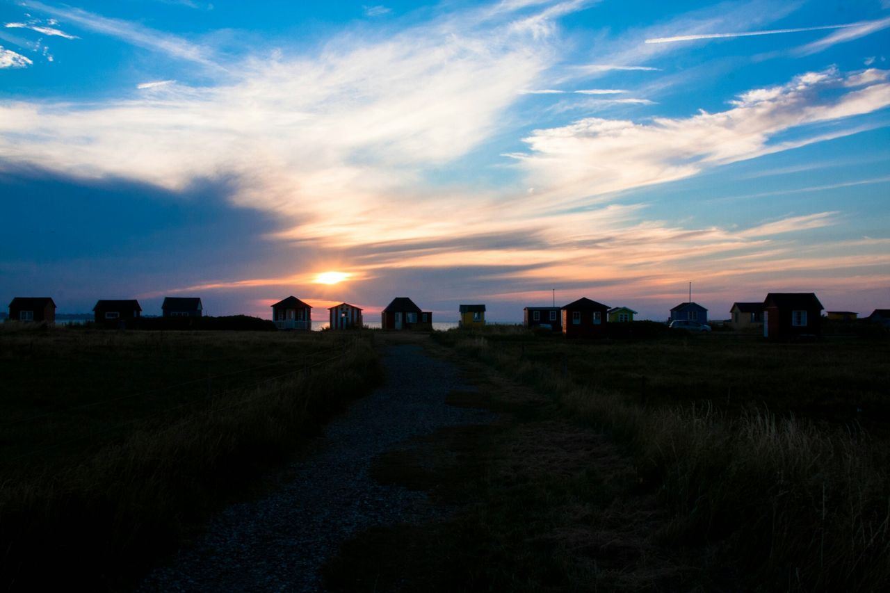 Silhouette Of Beach Huts At Coast