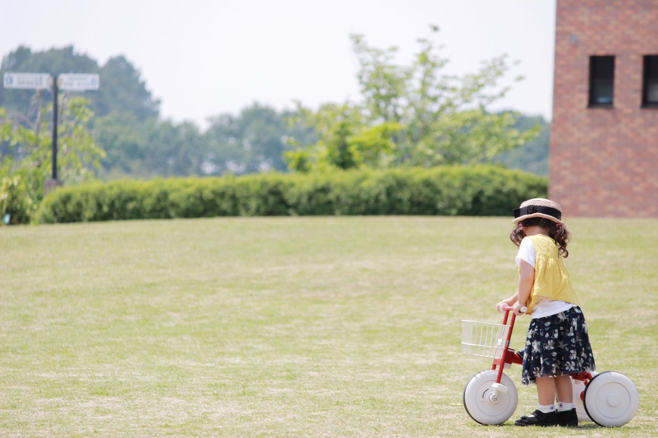 Grass Childhood Full Length Real People One Person Girls Leisure Activity Lifestyles Playing Architecture Sky Funny Faces Future Japanese  Child Holiday Happy Tricycle