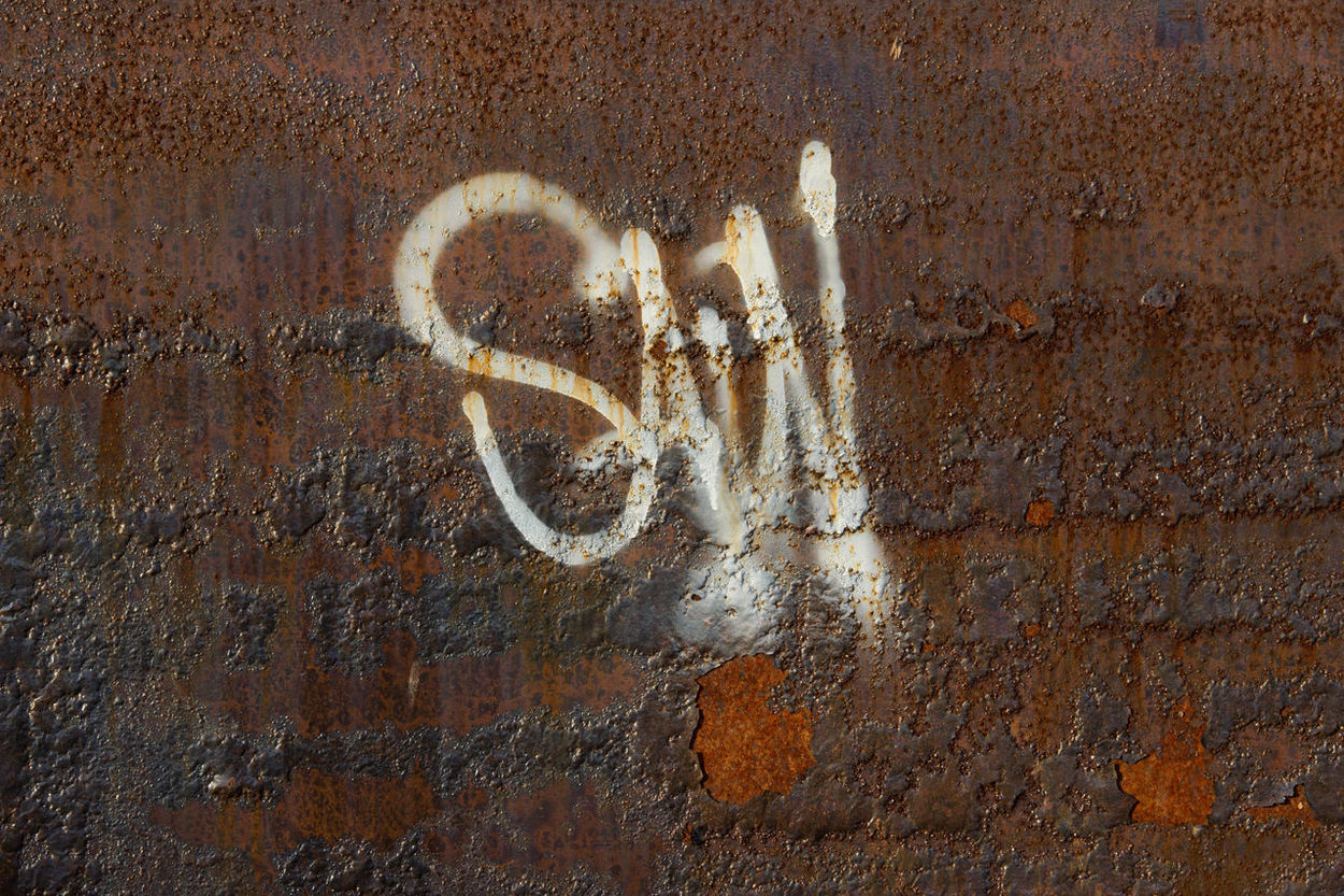 Adapted To The City Day Graffiti No People Old Wall Outdoors Rustic Rusty Rusty Wall Wall Abstract Photography Abstract Rusty Metal Minimalist Architecture Rusty Things Rusty Steel Rusty Surface The Street Photographer - 2017 EyeEm Awards BYOPaper!