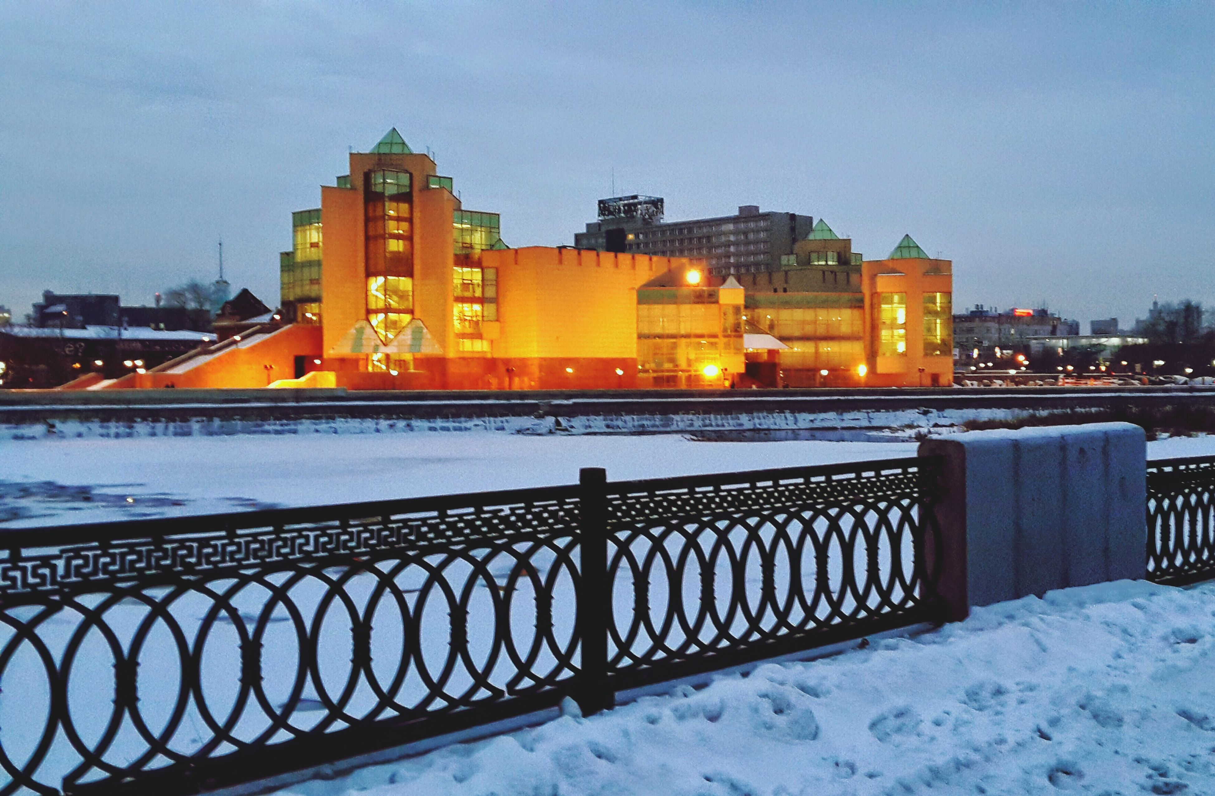 snow, winter, cold temperature, season, building exterior, architecture, built structure, illuminated, sunset, weather, frozen, covering, sky, dusk, railing, night, street light, outdoors, covered, orange color