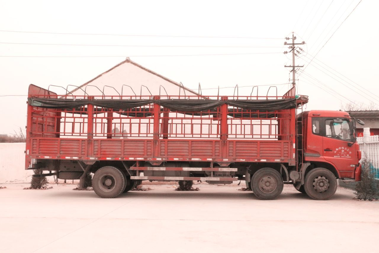 transportation, mode of transport, red, land vehicle, freight transportation, cold temperature, day, outdoors, no people, winter