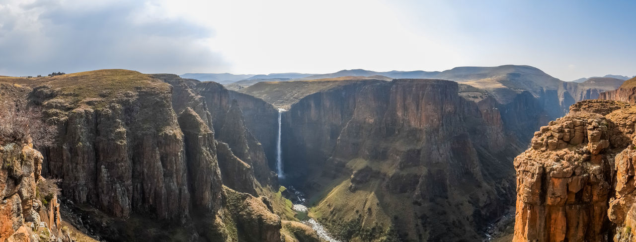 Panorama of the 192m high Maletsunyane Falls and large canyon in the mountainous highlands near Semonkong, Lesotho, Africa. Gorge Lesotho Panorama Panoramic Water Falls Africa Attraction Canyon Destination Maletsunyane Mountains Panoramic Photography Waterfall