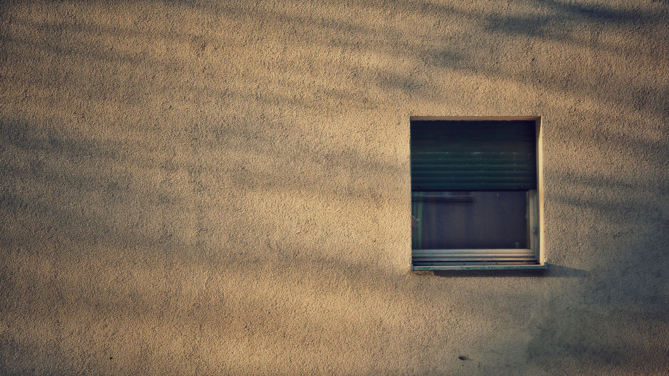a wall with a window - urban summer atmosphere Architecture Building Exterior Built Structure Close-up Day Indoors  Neukölln No People Shadows & Lights Warm Light Window Strassenfilm