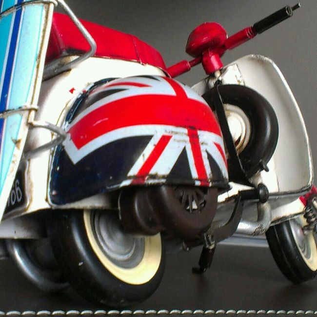 A model motor scooter with Union Jack engine covers and surf boards. Copyright Protected by Adrian Brown. Photo28.