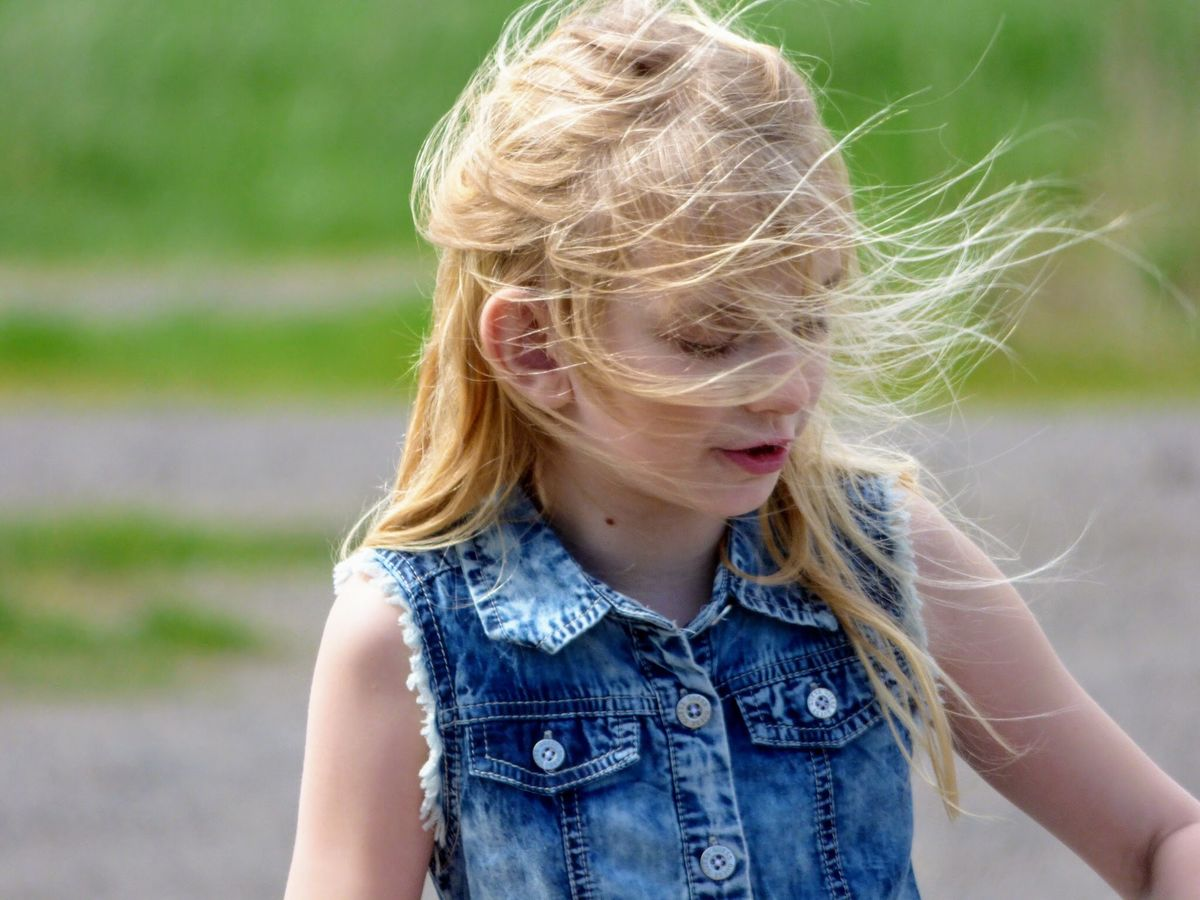 Blond Hair Childhood Children Only Close-up Day Denim Jacket Focus On Foreground Girls One Girl Only One Person Outdoors People Selected For Premium. Selected For Premium Hair In The Wind Hair In Face Hair Blowing In The Wind Long Blond Hair Long Hair Blonde Girl Blonde Hair Elementary Age Girl Child Farm Life