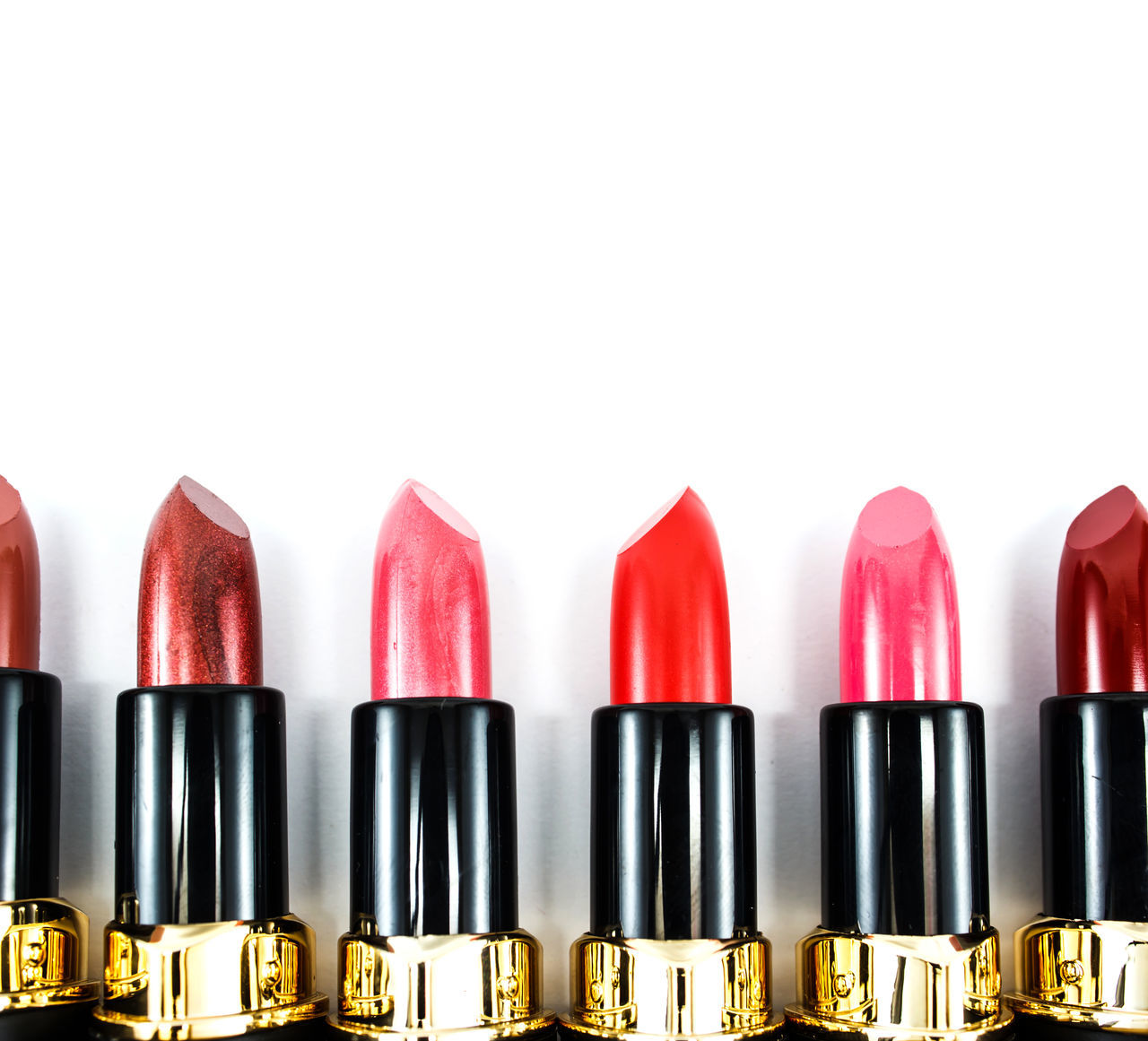 Lipstick colors isolated on a white background to form a page border Background Beauty Black Border Care Colors Coral Cosmetics Edge Flat Golden Lay Lippy Lips Lipstick Make Makeup Page Pink Product Purple Red Set Stick Up