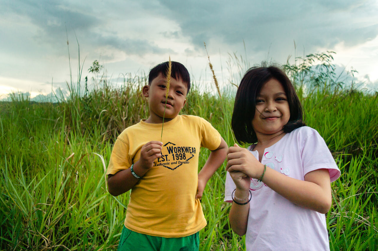 My family. Senyum mereka adalah senyumku. ☺😊 Uniqueness Two People Togetherness Portrait Grass Outdoors Cloud - Sky Smiling People Happiness Real People Growth Plant Beauty In Nature Kid Kid Playing
