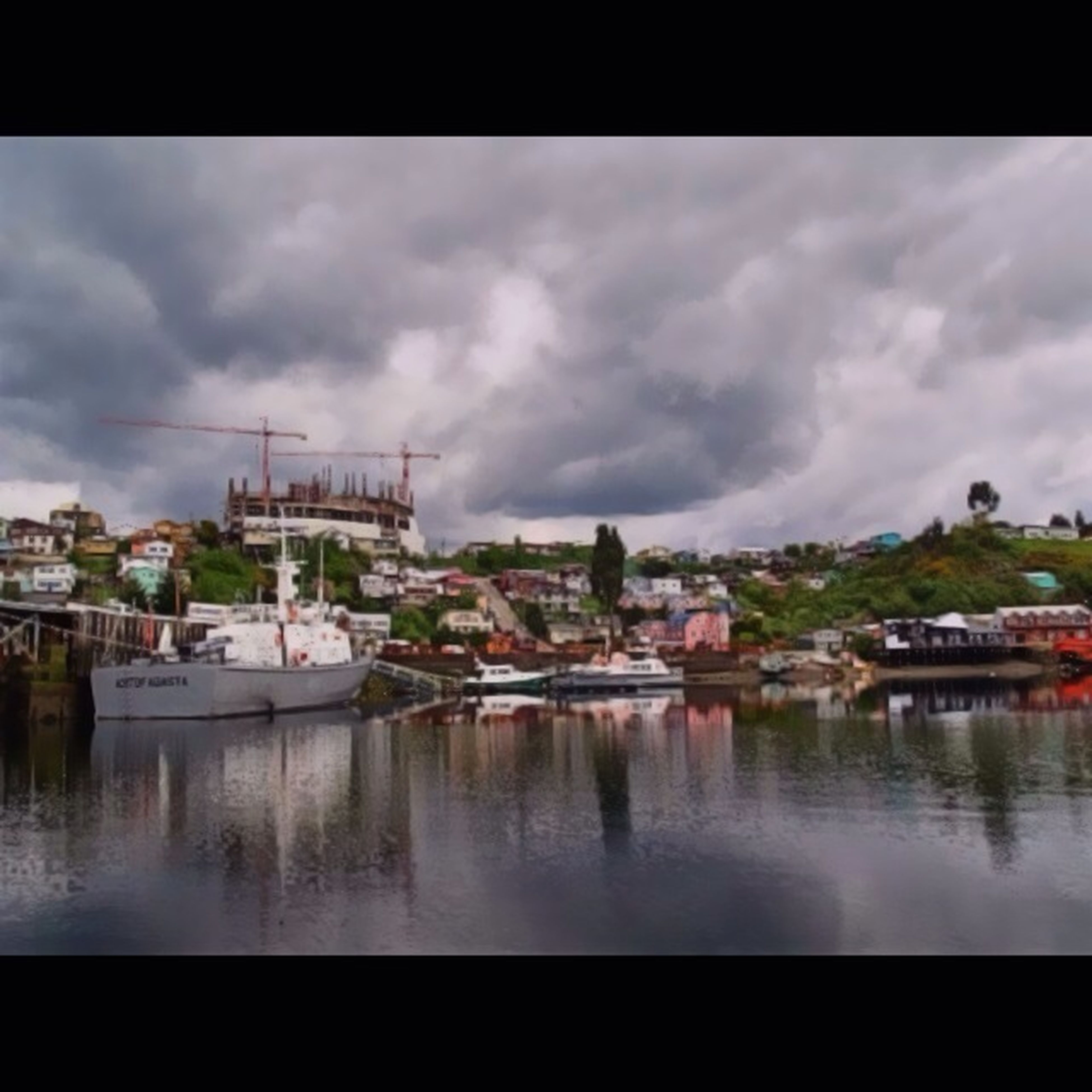 water, transfer print, architecture, building exterior, built structure, sky, nautical vessel, cloud - sky, auto post production filter, waterfront, river, cloudy, transportation, boat, cloud, harbor, mode of transport, moored, house, town