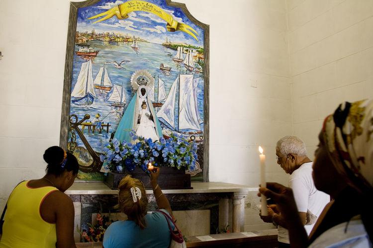 Adult Afrocuban Art And Craft Candles Indoors  Ocha Orisha Orishas Praying Regla Religion Santera Santeria Spirituality Statue Virgen De Regla Yemaya Miles Away