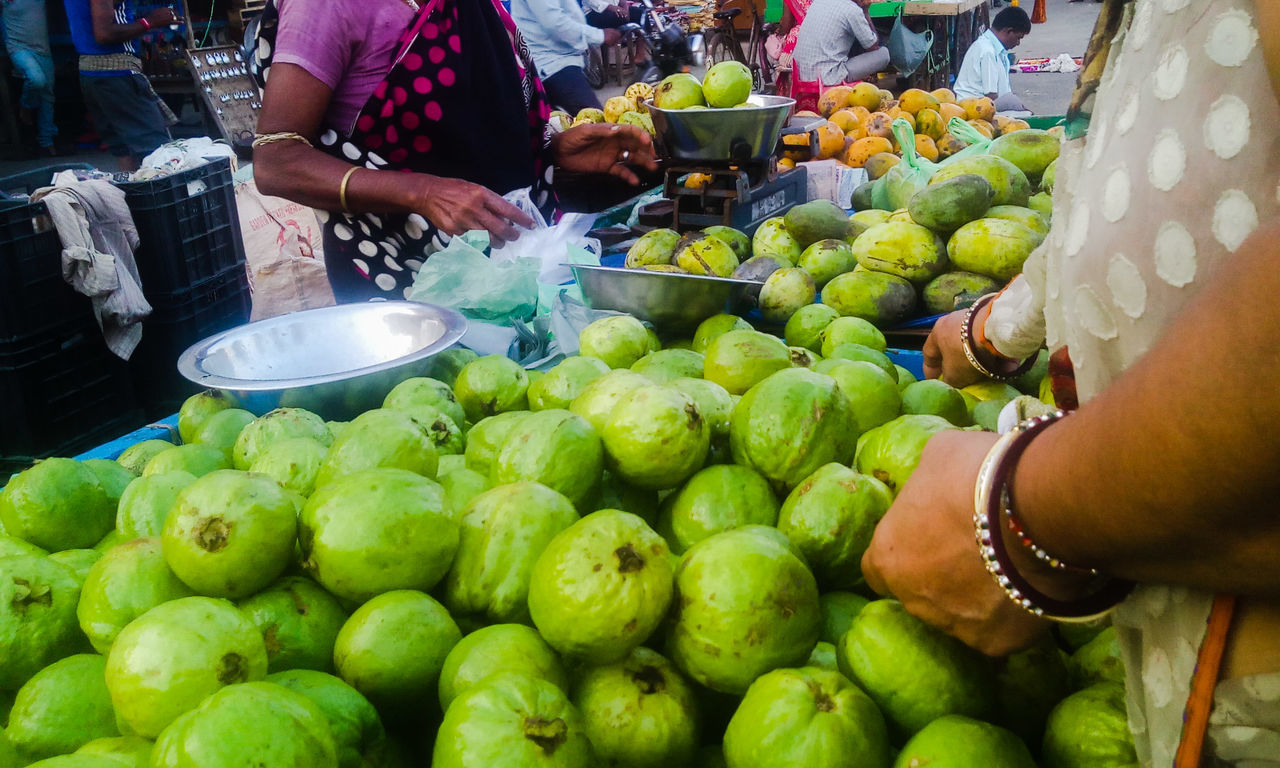 Streetphotography Buyers And Sellers Street Seller Market Stall Seller And Customer Selling On The Street Street Photography EyeEm Gallery From My Point Of View Market Guava  Guava Fruit Guavas