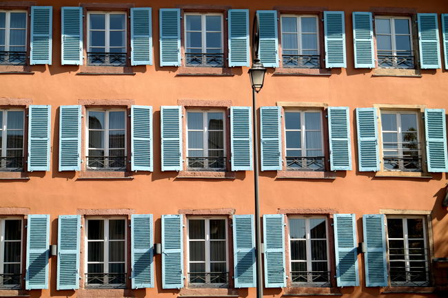 Alsace Architecture Building Exterior Built Structure Colmar Colmar, Alsace, France Colorful Elsass Eye4photography  EyeEm Best Edits EyeEm Best Shots EyeEm Gallery EyeEm Masterclass France Housefront In A Row Multi Colored Pattern Pattern Pieces Side By Side Symetry Window Window View Windows