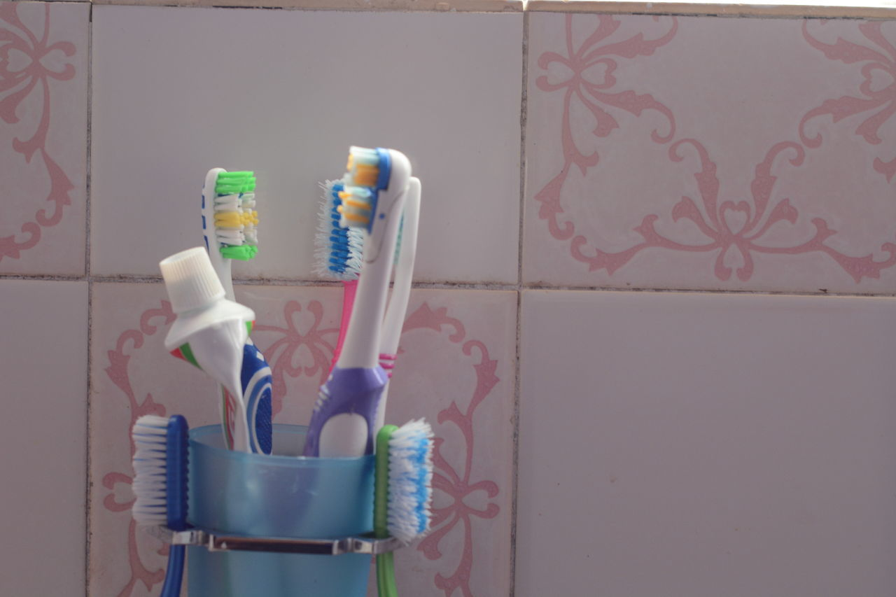 Teething Arragements Blue Bristles Brush Close-up Container Equipment Indoors  Multi Colored No People Plastic Still Life Teeth Toothbrush Toothbrushes Wall