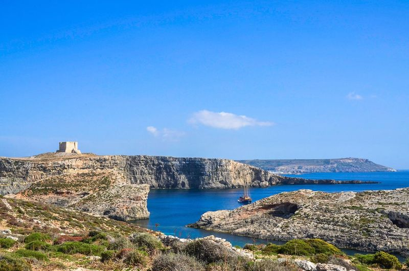 Saint Mary's Tower in Comino Island, Malta. Saint Mary's Tower St Marija Comino Island Malta Mediterranean Sea Mediterranean  Maltese Boats Riviera Vacation Fort Tower Bastion Travel Tourism Scenics Blue Sky Blue Sea Ocean Holidays Saint Marija Castle Fortress Blue Lagoon