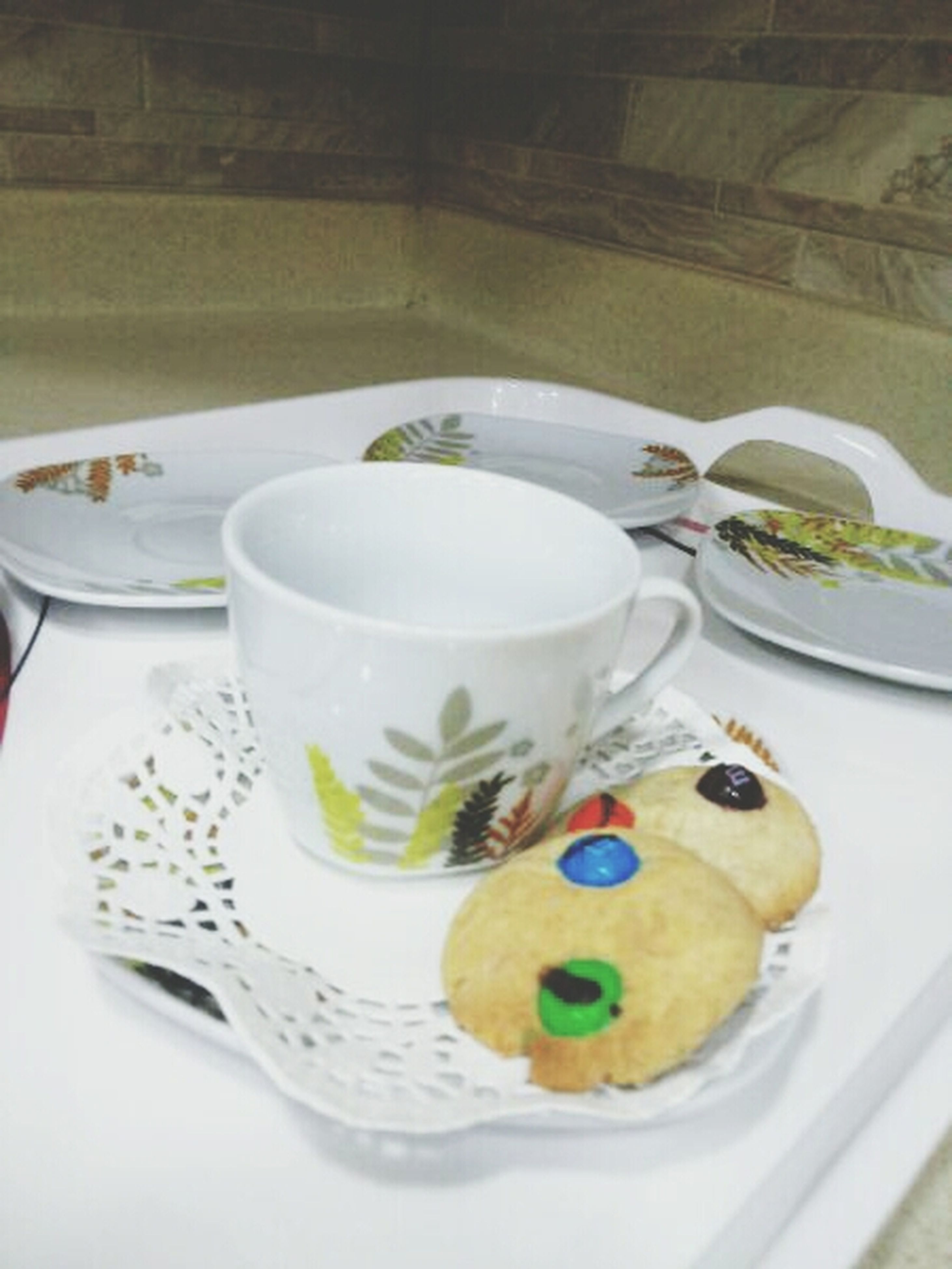 indoors, food and drink, freshness, still life, table, sweet food, coffee cup, drink, plate, food, refreshment, high angle view, ready-to-eat, saucer, coffee - drink, dessert, cup, indulgence, breakfast, spoon