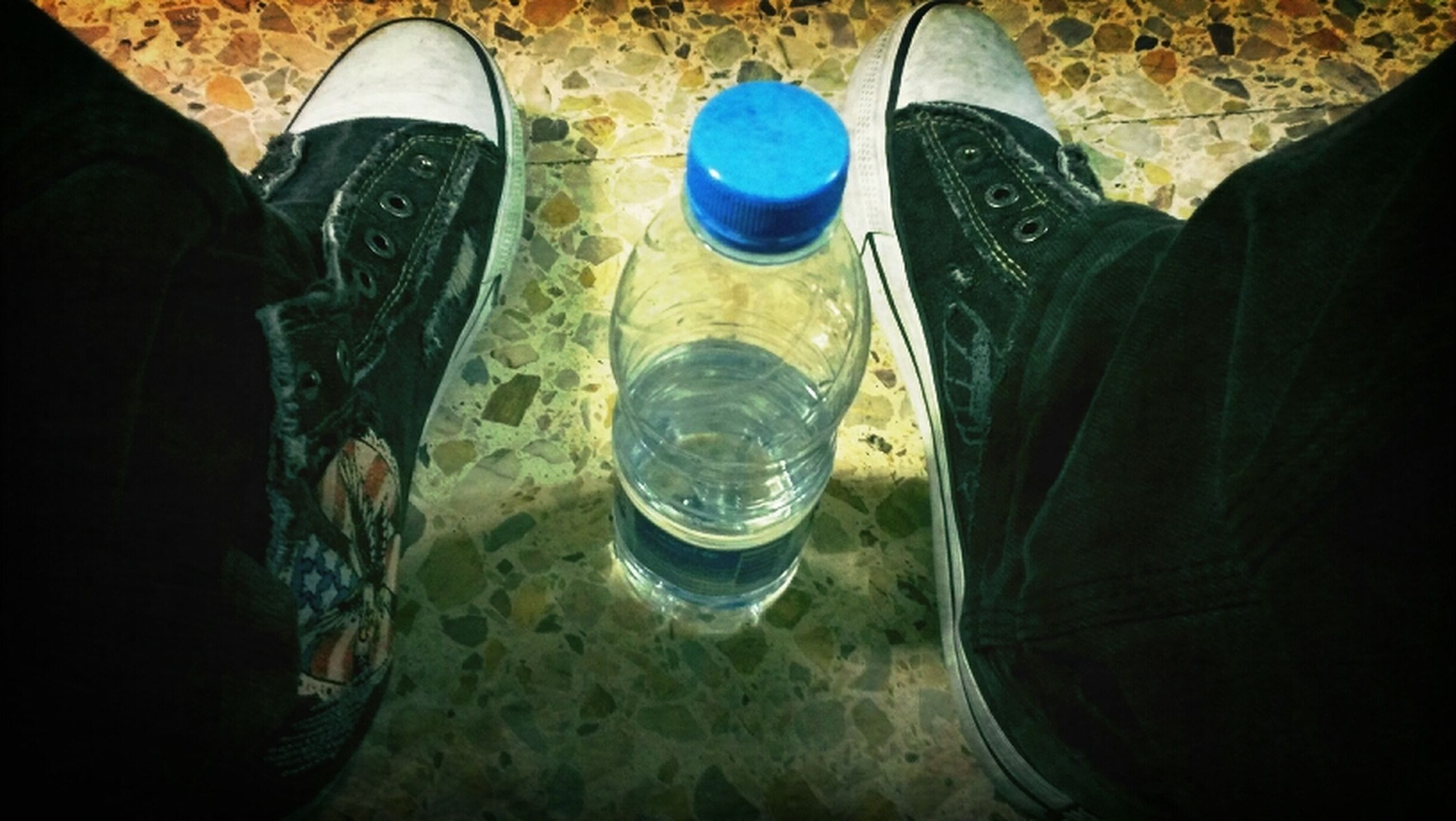 low section, person, shoe, high angle view, lifestyles, standing, men, indoors, personal perspective, human foot, leisure activity, footwear, jeans, unrecognizable person, directly above, water, casual clothing