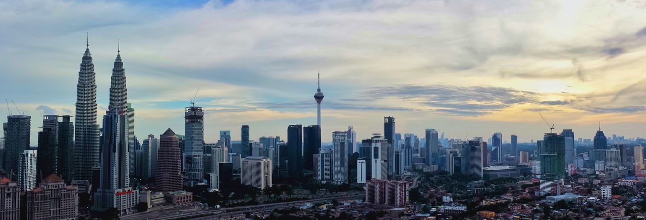 skyscraper, architecture, city, building exterior, tall - high, tower, built structure, modern, cityscape, travel destinations, urban skyline, sky, cloud - sky, financial district, downtown district, outdoors, no people, sunset, day