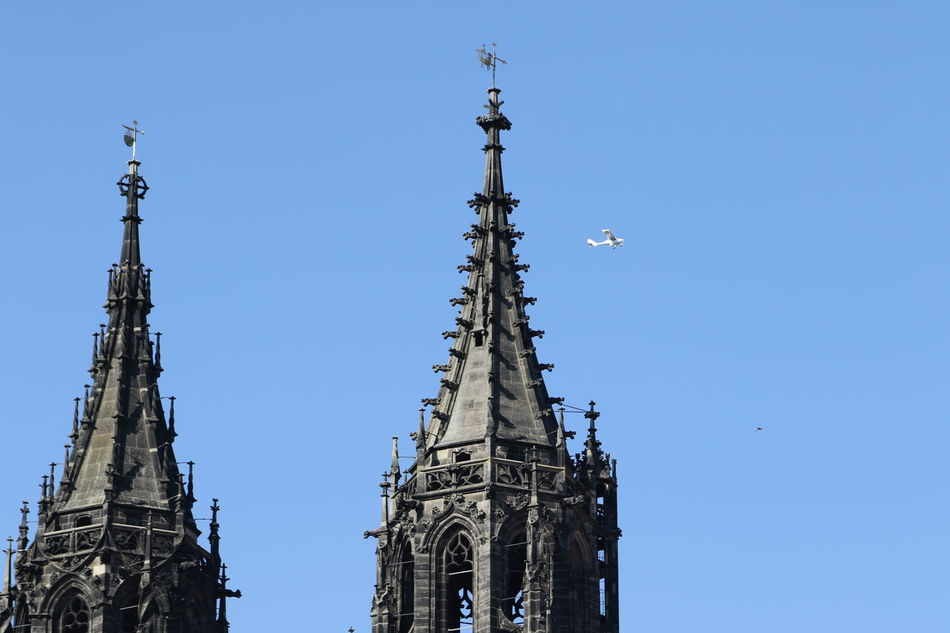Airplane Passing By Church Church Towers Day Dome No People Outdoors Sky Twin Towers