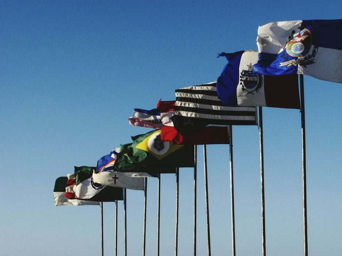 Low Angle View Blue Travel Destinations Beachphotography Mix Yourself A Good Time Fortaleza Fortaleza - Ce Beachlovers Flags Flags In The Wind  Fortaleza Flag Bandeiras Outdoors Sky