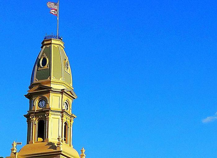 Tower Old Building  Old Architecture Old Flag Pole Flags In The Wind  Flag In The Wind Flags Flagpole Flag United States Flag  Ohio, USA Ohio Flag State Flag Ohio Bellefontaine Bellefontaine, Ohio Building And Sky Building Exterior Building Dome Blue Sky Clock Tower Clocktower Clocks
