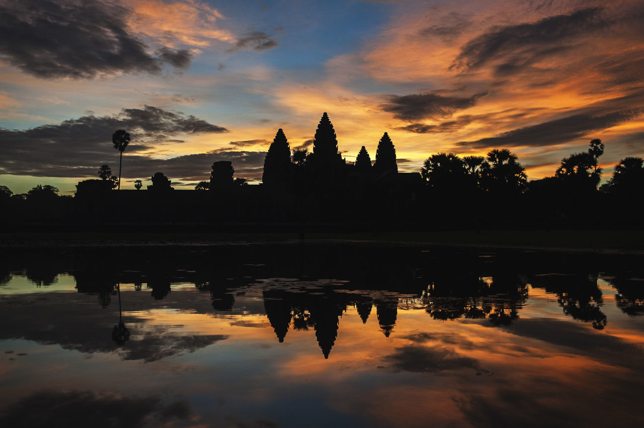 sunset, reflection, built structure, sky, architecture, cloud - sky, silhouette, orange color, religion, travel destinations, water, building exterior, spirituality, nature, place of worship, tourism, beauty in nature, outdoors, tree, scenics, lake, no people