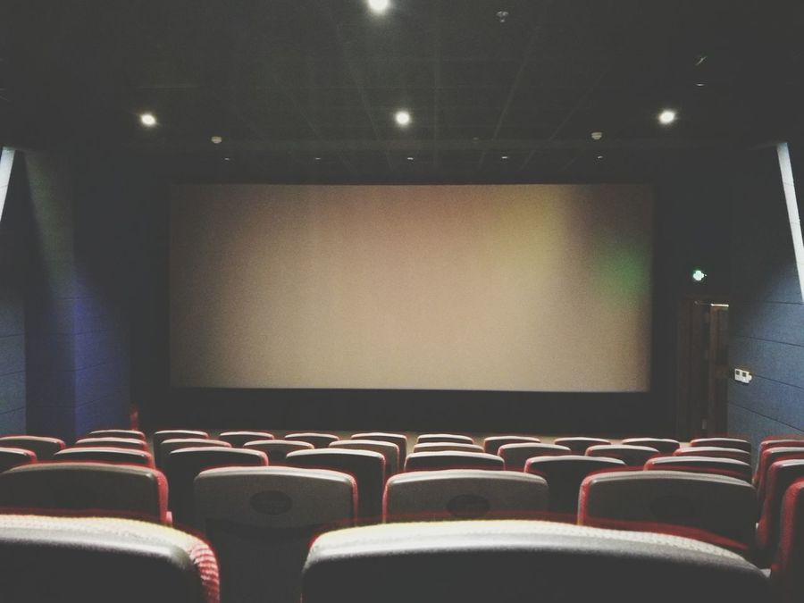 Movie Theater Arts Culture And Entertainment Indoors  Auditorium Seat Projection Screen Red Film Industry No People MOVIE Performing Arts Event Nightlife