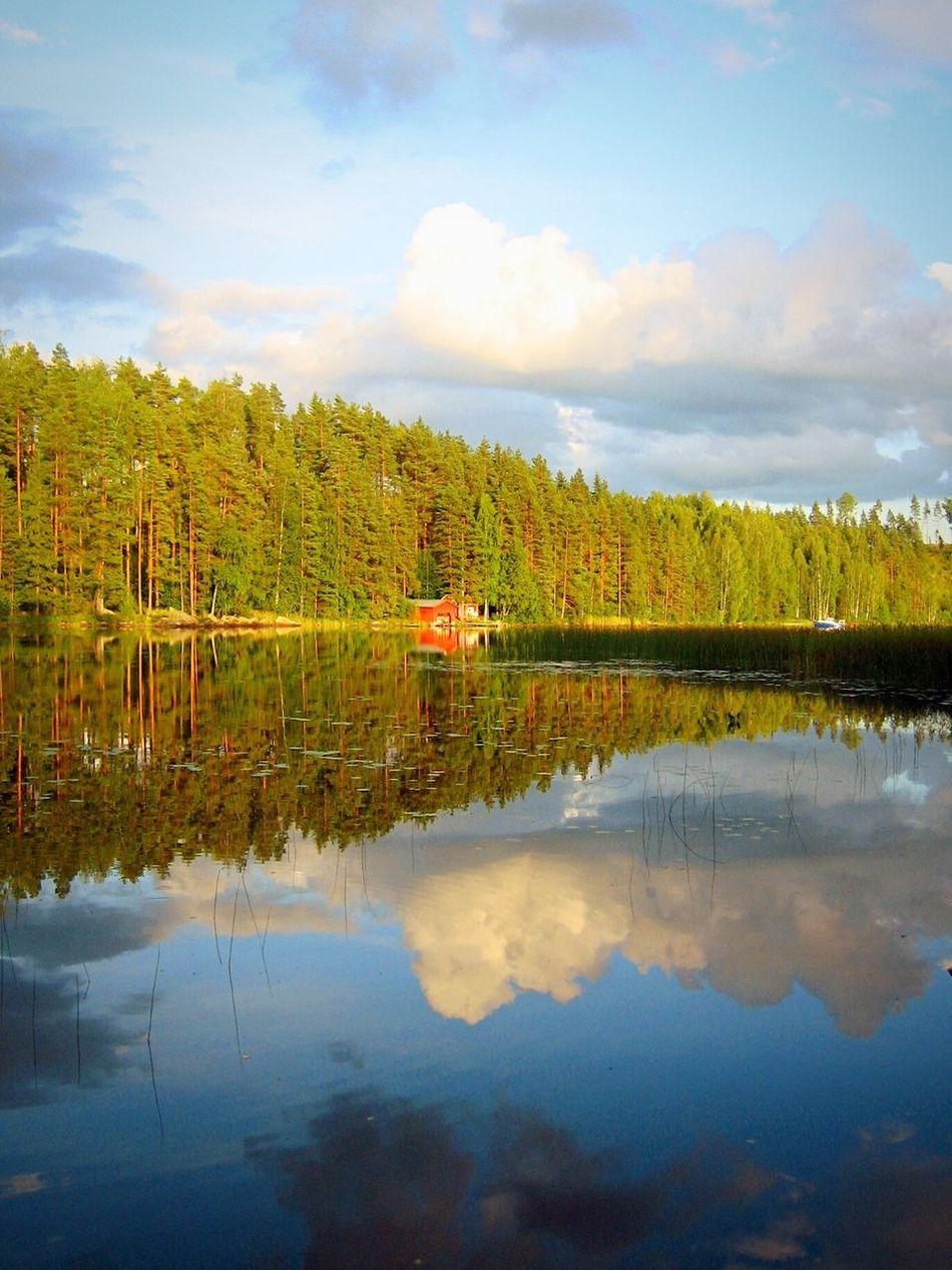 Badehaus. Reflection Finland Scenics Nature Sky Beauty In Nature Water Lake Tree Tranquil Scene Tranquility No People Idyllic Day Outdoors Light And Shadow Sky And Clouds Mirror Wonderful Finland Summer Alone Time Evening Light The Week On Eyem Power In Nature Colorful
